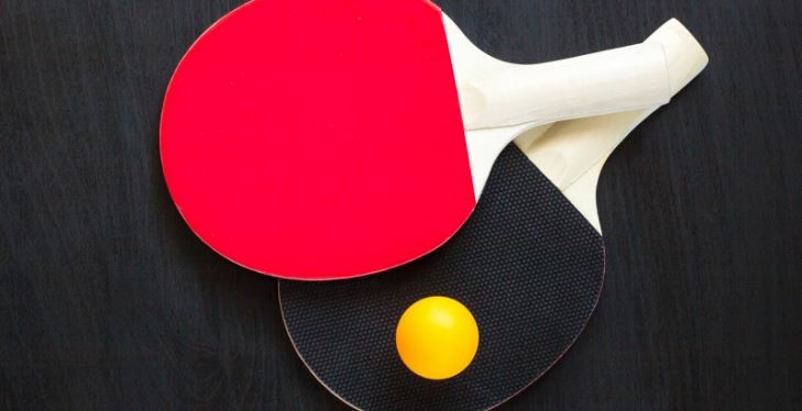 Difference between red and black side of a ping pong paddle.